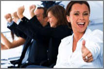 Woman giving thumbs up after a successful presentation